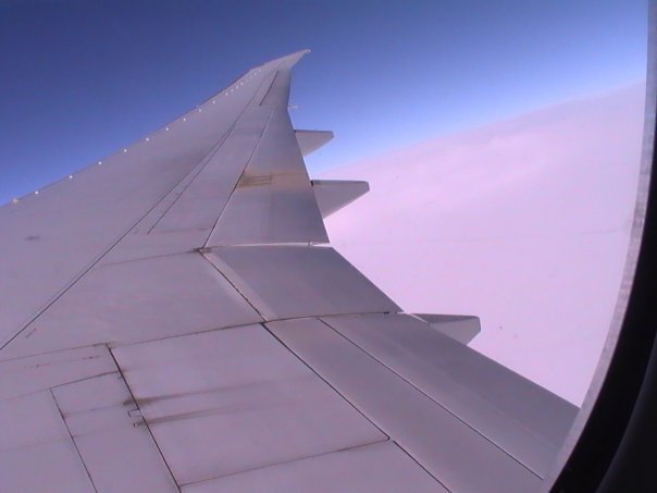 Boeing wing. Flying over the clouds