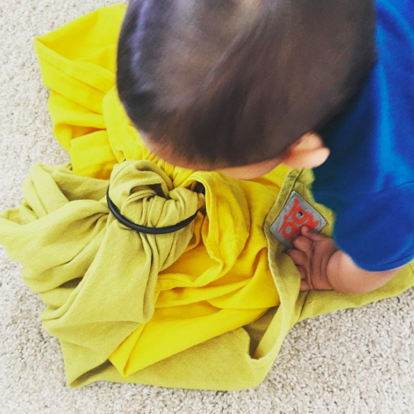 Baby playing with his first Kol Kol ring sling