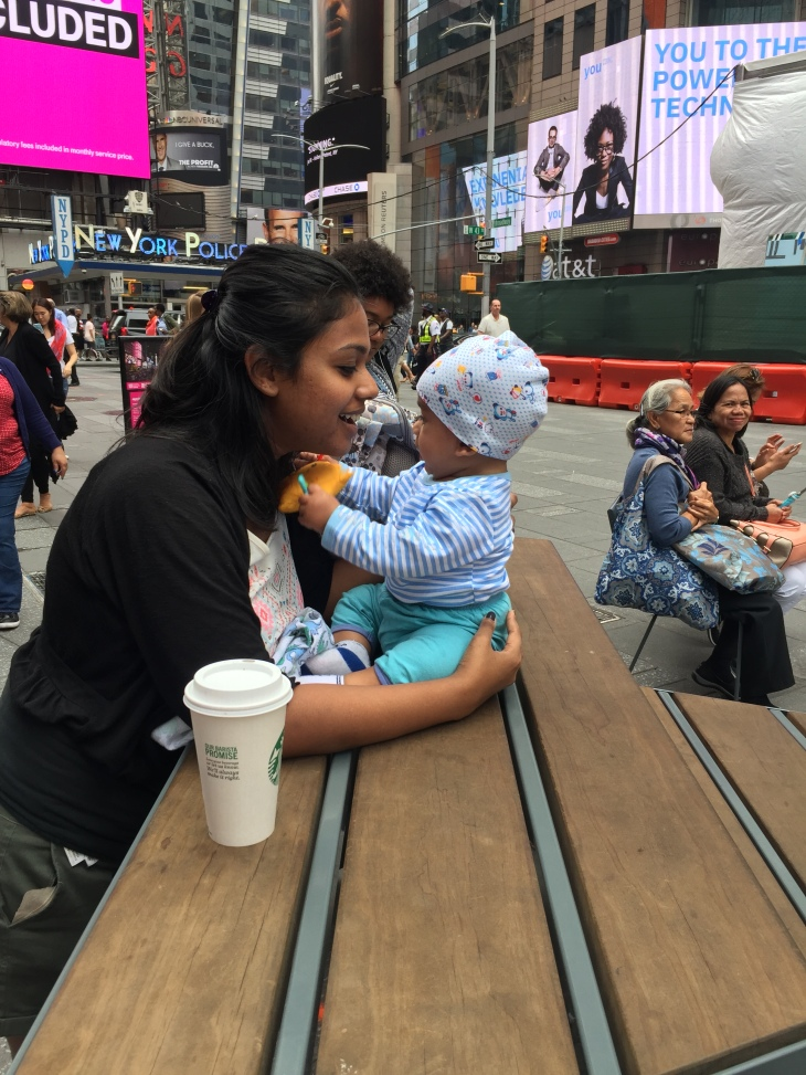 Mom and baby enjoying a day at Times Square