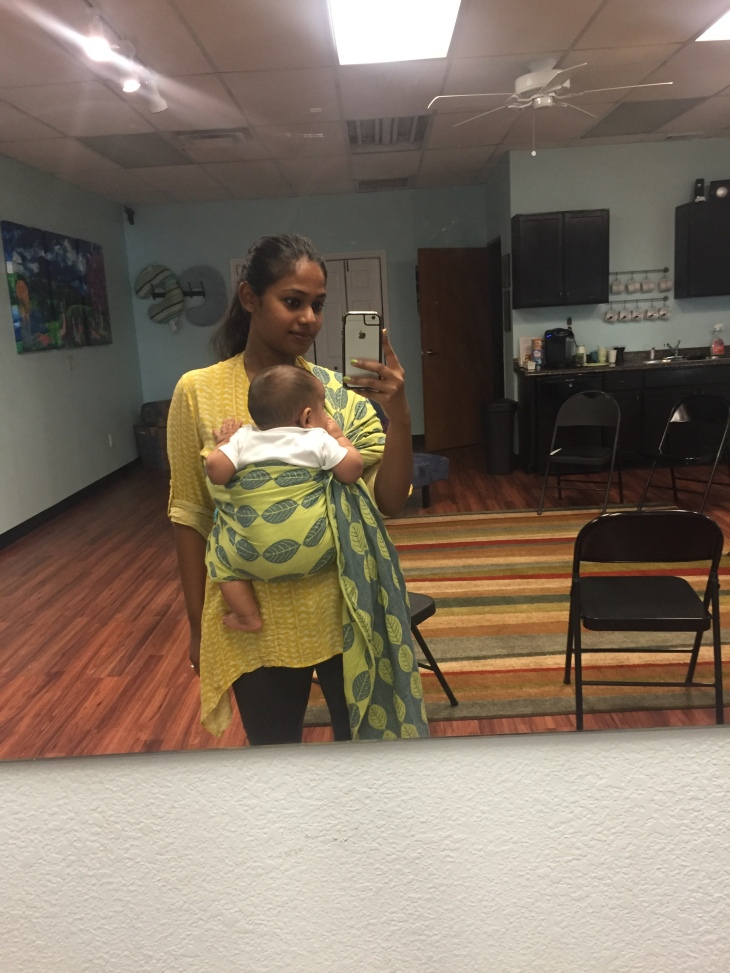 Mother wearing baby in Soul Ring sling