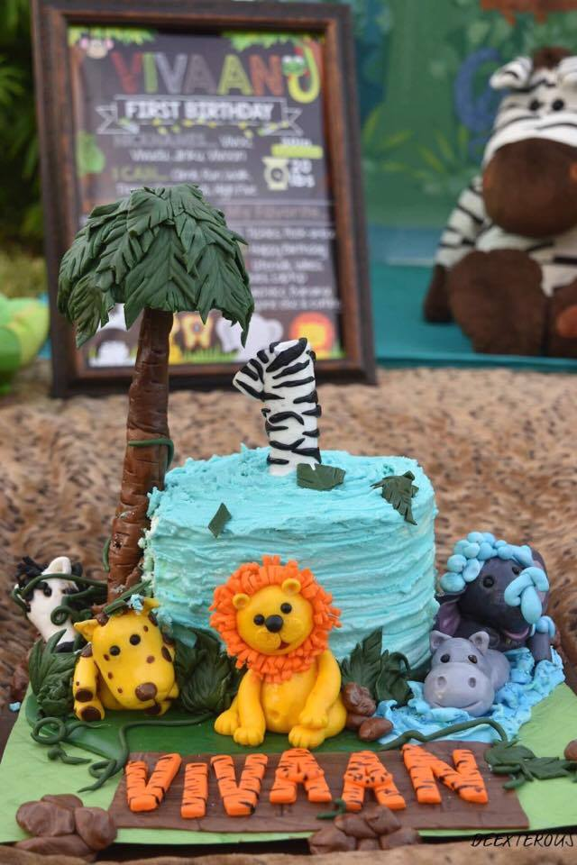 Jungle theme smash cake in outdoor or indoor setting