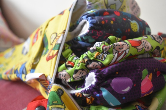 Stash of cloth diapers by Super bottoms India along with a super bag (wet bag) to store used cloth diapers